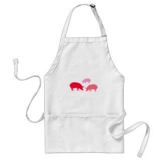 Cerdos que buscan la comida roja delantales