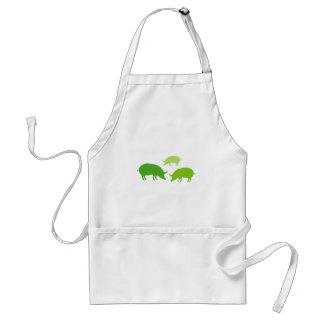 Cerdos que buscan la comida verde delantales