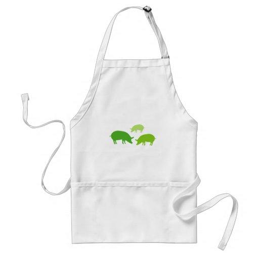 Cerdos que buscan la comida (verde) delantales