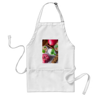 Cereal with walnuts and raisins, yogurt and apples adult apron