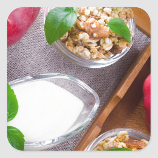 Cereal with walnuts and raisins, yogurt and apples square sticker