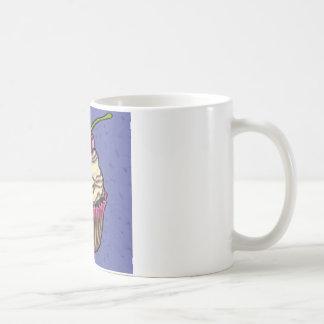 Cereza en azul taza de café