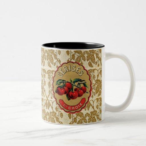 Cerezas francesas del vintage etiquetadas taza