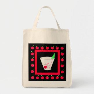 Cerezas rojas de la bebida retra pasada de moda en bolsa tela para la compra