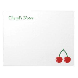 Cerezas rojas que escriben los cuadernos de notas
