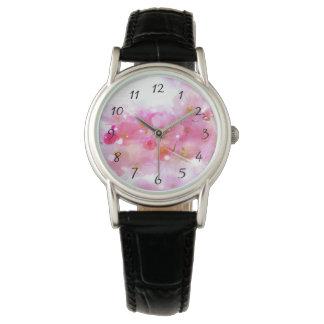 Cerezo japonés con los flores del rosa en colores reloj de mano