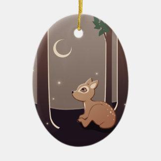 Cervatillo del bosque con las luciérnagas y el adorno navideño ovalado de cerámica