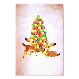 Cervatillos del vintage por el árbol de navidad de fotografías