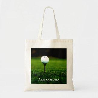 Césped de la hierba verde y pelota de golf/camiset bolsa de mano