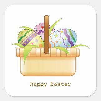 Cesta con el pegatina de los huevos de Pascua
