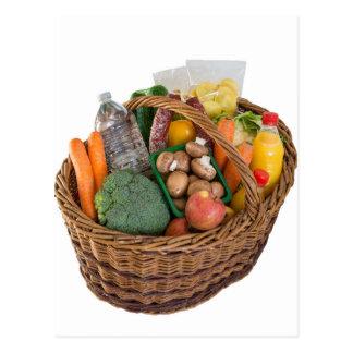 Cesta de compras con las frutas y verduras de las tarjeta postal