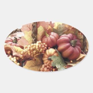 Cesta de la calabaza de otoño pegatina ovalada