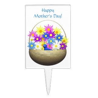 Cesta feliz del día de madres de margaritas y de p palillos de tarta