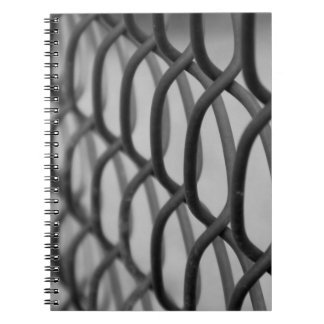 chain link fence spiral notebooks