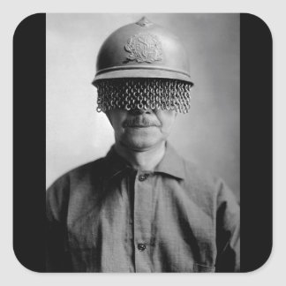 Chain screens on steel helmet to_War image Square Sticker