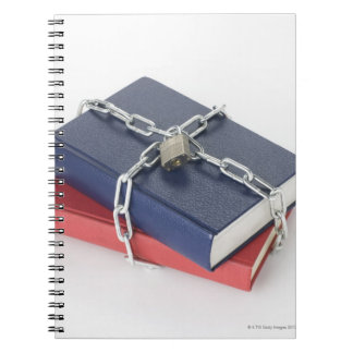 Chained stack of books spiral notebooks