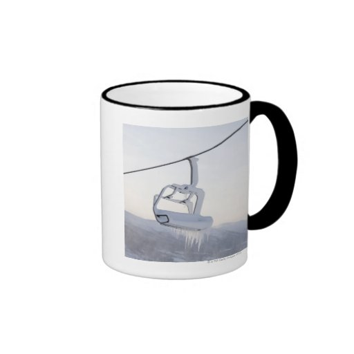 Chair lift full of snow and ice ringer coffee mug