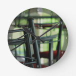Chairs in abstract round wall clocks