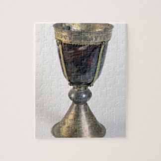 Chalice with jewels and an inscription on the bord puzzles