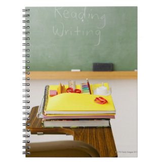 Chalkboard in classroom spiral note books