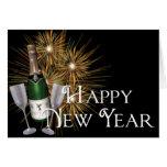Champán y tarjeta de felicitación de la Feliz Año