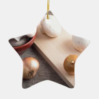 Champignon mushrooms and onions on the table ceramic ornament