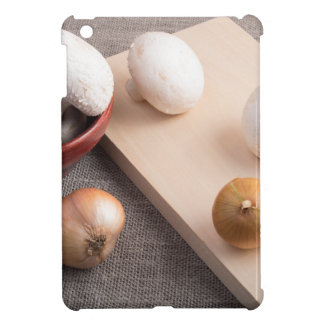 Champignon mushrooms and onions on the table iPad mini cover