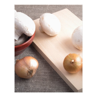 Champignon mushrooms and onions on the table letterhead