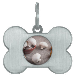 Champignon mushrooms and onions on the table pet ID tag