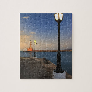 Chania Harbor and Venetian lighthouse at sunset Jigsaw Puzzle