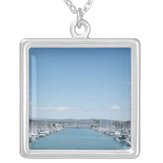channel in harbor on a sunny day with blue sky silver plated necklace
