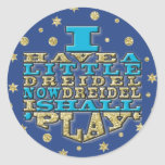 """Chanukah """"Dreidel Play/Gold,Blue"""" Stickers Round<br><div class=""""desc"""">Chanukah/Hanukkah """"I Have a Little Dreidel Now Dreidel I Shall Play/Gold, Blue"""" Stickers Round. Have fun using these stickers as cake toppers, favor bag closures, or whatever rocks your festivities! The background can be changed by choosing from a large selection of colors. Thanks for stopping and shopping by! Your business...</div>"""