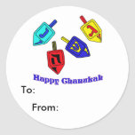 Chanukah Dreidels Classic Round Sticker<br><div class='desc'>A Happy Chanukah gift featuring 4 dreidels with Hebrew letters which represent A Great Miracle Happened There!</div>