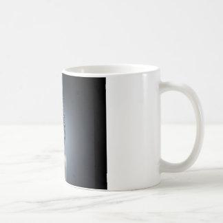 chapoteo abstracto del agua de la vela del fuego taza de café