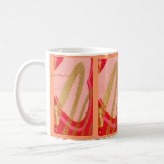 ¡Chapoteo de la chispa! La taza del té del café