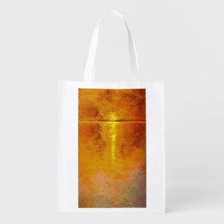 Chapoteo de la puesta del sol bolsa para la compra