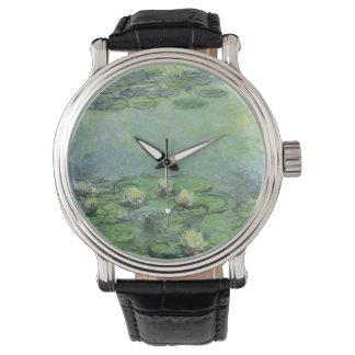 Charca del lirio de agua en pastel relojes de pulsera