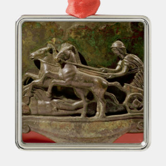 Charioteer in his chariot, detail from a cist metal ornament