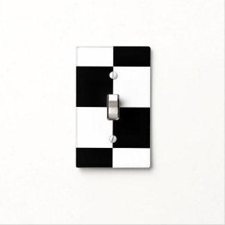 Checkerboard pattern light switch plates