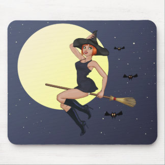 Cheeky cartoon witch with a flying broomstick mouse pad