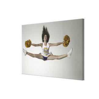 Cheerleader doing splits in mid air canvas print