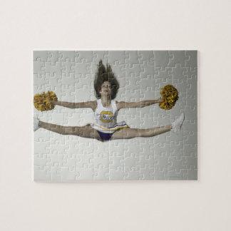 Cheerleader doing splits in mid air jigsaw puzzle