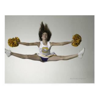 Cheerleader doing splits in mid air postcard