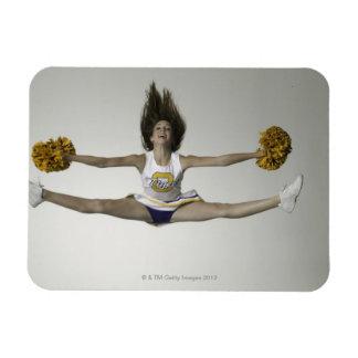 Cheerleader doing splits in mid air rectangular photo magnet