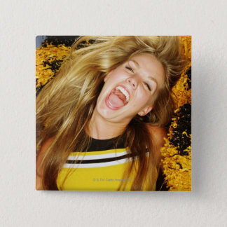 Cheerleader flipping hair, laughing, surrounded pinback button