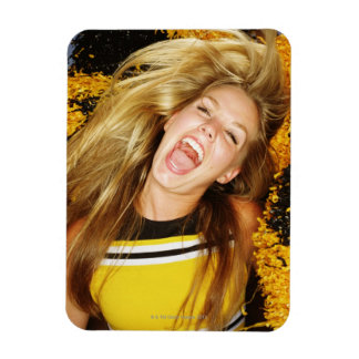 Cheerleader flipping hair, laughing, surrounded vinyl magnets
