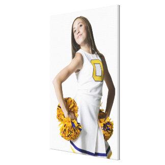 Cheerleader holding pom-poms canvas print