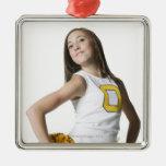 Cheerleader holding pom-poms christmas ornament