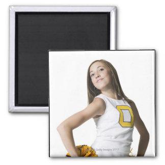 Cheerleader holding pom-poms magnet