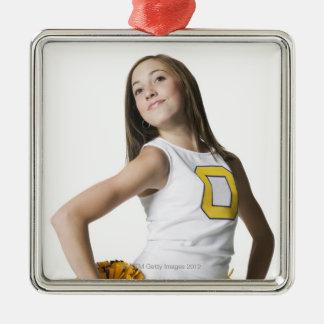 Cheerleader holding pom-poms square metal christmas ornament